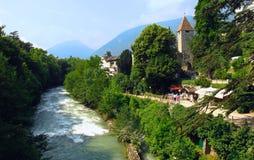 Merano Italy Passer River spring summer Alps. Merano, Italy - June 16, 2013: The Passer River rushes through the spa town of Merano in Italy's South Tirol region Stock Image
