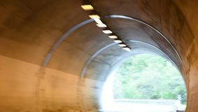 People driving car on the road passed mountain in car tunnel go to Meran city. MERANO, ITALY - SEPTEMBER 2 : Italian people and foreigner travelers driving car stock footage