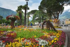 South Tyrol, a beautiful city of Trentino Alto Adige, View on the famous promenade along the Passirio river. Merano/Italy - 05/05/18: in South Tyrol, a beautiful stock photo