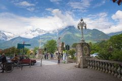 South Tyrol, a beautiful city of Trentino Alto Adige, View on the famous promenade along the Passirio river. Merano/Italy - 05/05/18: South Tyrol, a beautiful royalty free stock images
