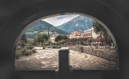 Merano river passirio view from a hole. Meran, Italy, 11 Aug 2017: Merano river passirio as view from a hole stock photos
