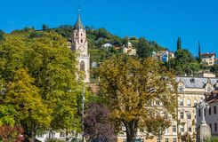 Merano in South Tyrol, a beautiful city of Trentino Alto Adige, Autumn view of the Cathedral of Meran. Italy. Merano in South Tyrol, a beautiful city of stock photos