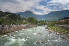 Merano in South Tyrol, a beautiful city of Trentino Alto Adige. View on the famous promenade along the Passirio river. Northern Italy royalty free stock photos