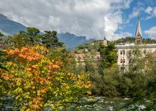 Merano in South Tyrol, a beautiful city of Trentino Alto Adige, View on the famous promenade along the Passirio river. Italy. Stock Photos