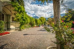 Merano in South Tyrol, a beautiful city of Trentino Alto Adige, View on the famous promenade along the Passirio river. Italy.