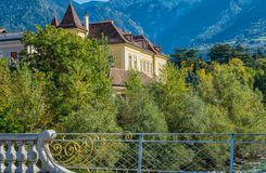 Merano in South Tyrol, a beautiful city of Trentino Alto Adige, View on the famous promenade along the Passirio river. Italy. Royalty Free Stock Image