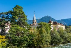 Merano in South Tyrol, a beautiful city of Trentino Alto Adige, View on the famous promenade along the Passirio river. Italy. Merano in South Tyrol, a beautiful stock photo