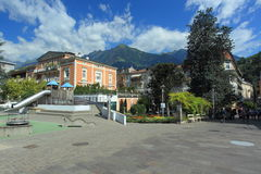 Merano. The spa colonade and surrounding peaks of South Tyrolean mountains in Merano, Italy Royalty Free Stock Photo