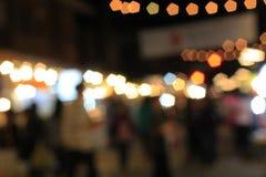 Mercado borroso de la Navidad por la tarde Foto de archivo libre de regalías
