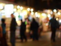 Mercado borroso de la Navidad por la tarde Imágenes de archivo libres de regalías