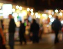 Mercado borroso de la Navidad por la tarde Fotos de archivo libres de regalías