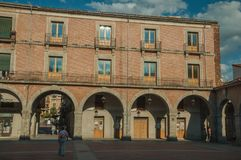 Mercado Chico Square encircled by old building with arches at Avila. Avila, Spain - July 22, 2018. People on the Mercado Chico Square encircled by old building royalty free stock image