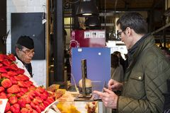 Mercado San Miguel market with food courts and delicacies is a popular place among tourists and city dwellers. MADRID, SPAIN -  28 MARCH, 2018: Mercado San Stock Photography