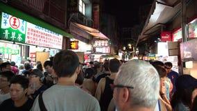mercado Shilin da noite de 4k Taiwan Os povos da multidão que andam na rua filme
