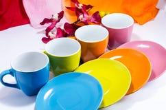 Mercancías coloridas con una flor Fotos de archivo
