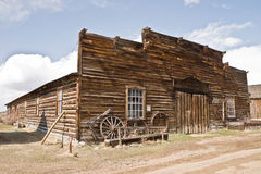 Mercantile in a Ghost Town. Abandoned mercantile with wagon wheels in front in the ghost town of Nevada City, Montana Stock Photo