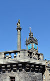 The Mercat Cross, Glasgow, Scotland, with the Tolbooth steeple b Royalty Free Stock Photo