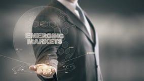 Mercati emergenti con il concetto dell'uomo d'affari dell'ologramma illustrazione vettoriale