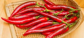 Merce nel carrello del peperoncino rosso Fotografia Stock Libera da Diritti