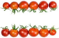 Merce nel carrello rossa fresca dei pomodori su fondo bianco Fotografie Stock Libere da Diritti