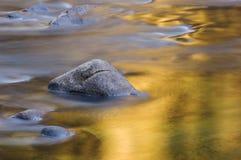 Merced River. With golden reflections Yosemite National Park, California, USA Stock Photos