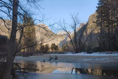 Merced River In Winter, Yosemite. Winter reflections on a tranquil morning along the Merced River, captured in Yosemite National Park, California Stock Photo
