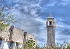 Mercede steeple under a cloudy sky Stock Images