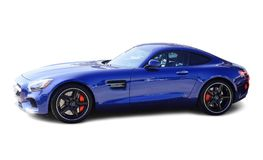 Mercedes AMG GT Blue on White Background. If the Mercedes-AMG GT is a reinvention of the pure sports car, there`s only one way to make it even purer: Open it up Stock Photos