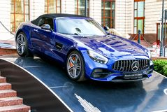 Mercedes-AMG GT C. Moscow, Russia - May 2, 2018: Brand new blue supercar Mercedes-AMG GT C in the city street Stock Images