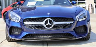 Mercedes AMG GT front end blue. If the Mercedes-AMG GT is a reinvention of the pure sports car, there`s only one way to make it even purer: Open it up. With the Royalty Free Stock Images