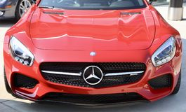 Mercedes AMG GT Front end Red. If the Mercedes-AMG GT is a reinvention of the pure sports car, there`s only one way to make it even purer: Open it up. With the Stock Image