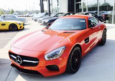 Mercedes AMG GT Red Side View. If the Mercedes-AMG GT is a reinvention of the pure sports car, there`s only one way to make it even purer: Open it up. With the Stock Images