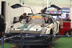 Mercedes AMG SLS race car. Mercedes AMG SLS for the Black River Caviar sponsored Race team sits in the garage at the professional motorsports racing event Royalty Free Stock Image