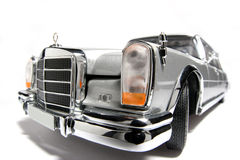 Mercedes Benz 600 metal scale toy car fisheye. Picture of a Mercedes Benz 600.  Taken with a fisheye lens as a highkey picture. Very hard to flash as the Stock Photo