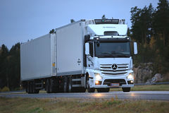 Mercedes Benz Actros Refrigerator Truck Late Night Trucking. PAIMIO, FINLAND - OCTOBER 14, 2016: White Mercedes-Benz Actros 2545 refrigerator truck of H. Mikkola Stock Photos
