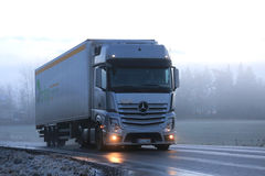 Mercedes-Benz Actros 1845 Semi Cargo Truck on Foggy Evening Stock Photo
