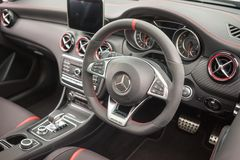 Mercedes-Benz AMG C43 Cope Interior view. An interior view of the Mercedes C43 Coupe sports car showing the steering wheel, leather seats and advanced driving royalty free stock photo