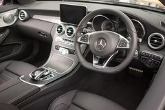 Mercedes-Benz AMG A45 Interior view. An interior view of the Mercedes A45 sports car showing the steering wheel, leather seats and advanced driving control royalty free stock images