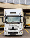 Mercedes-Benz Antos truck parked at a warehouse Royalty Free Stock Images