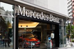 Mercedes benz building - germany car store. Mercedes-Benz is a German global automobile marque and a division of Daimler AG. The brand is known for luxury stock photos