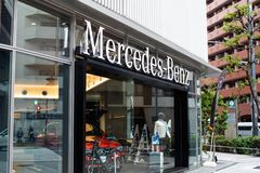 Mercedes benz building - germany car store. Mercedes-Benz is a German global automobile marque and a division of Daimler AG. The brand is known for luxury royalty free stock photos