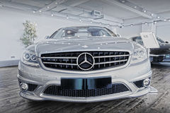 Mercedes Benz car and logo. Mercedes Benz luxury sports car in showroom with emblem / logo Stock Photo