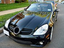 Mercedes Benz Coupe. Photo of a black mercedes benz sports car with the accent on the hood Stock Photos