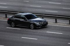 Mercedes benz E black speeding on empty highway Royalty Free Stock Images