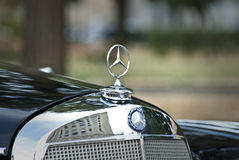 Mercedes-Benz emblem. MOSCOW-JULY 31:  Annual event 'Night Moscow Classic Rally', - the VI race of vintage cars, more than 50 crews, from owners to celebrities Royalty Free Stock Images