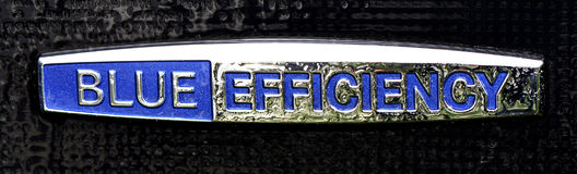 Mercedes Benz emblem of blue efficiency. On a ecofriendly car royalty free stock images