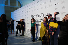 Mercedes-Benz Fashion Day St. Petersburg 2017. St. Petersburg, Russia - April 1, 2017: People make photos between fashion shows during Mercedes-Benz Fashion Day royalty free stock image