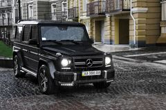 June 19, 2013. Ukraine, Kiev. Mercedes-Benz G55 AMG on the background of old houses. The car in the rain royalty free stock photo