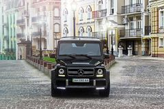 June 19, 2013. Ukraine, Kiev. Mercedes-Benz G55 AMG on the background of old houses stock photo