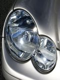 Mercedes Benz Headlight. Front headlight assembly on a Mercedes sports car Stock Image